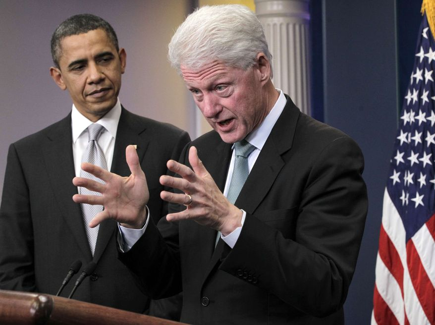 President Barack Obama looks on as former President Bill Clinton speaks in the briefing room of the White House in Washington on Friday, Dec. 10, 2010. (AP Photo/J. Scott Applewhite)
