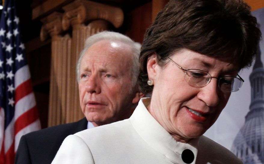 """Sen. Joe Lieberman and Sen. Susan Collins appear at a news conference after the defeat of a cloture motion of the Defense Authorization Bill containing repeal of the """"don't ask, don't tell"""" provision on Capitol Hill. (Associated Press)"""