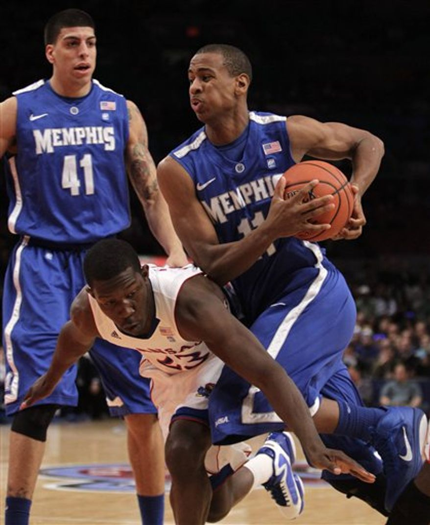 Memphis' Wesley Witherspoon (11) is defended by Kansas' Mario Little (23) in the first half of an NCAA college basketball game during the Jimmy V Classic  tournament  Tuesday, Dec. 7, 2010, in New York. (AP Photo/Frank Franklin II)