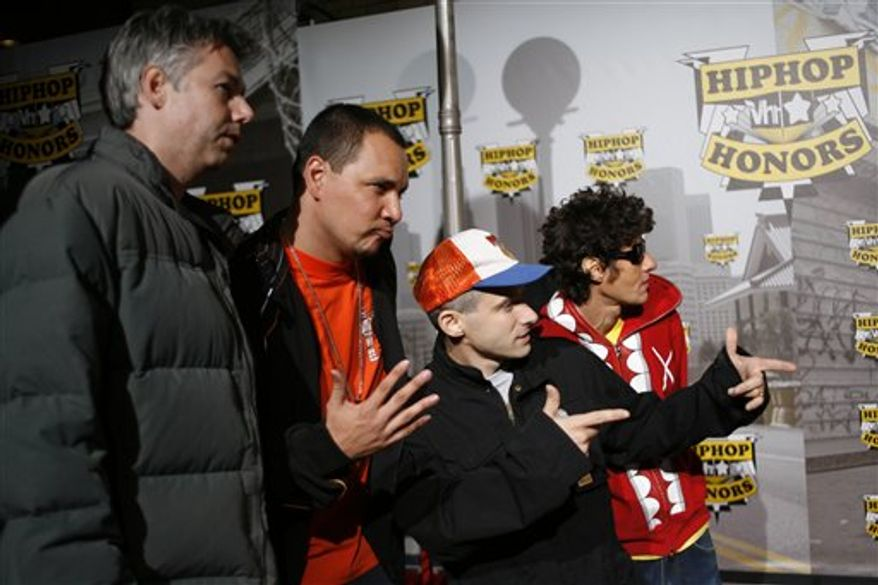 FILE in this Oct. 7, 2006 photo, The Beastie Boys, from left: Adam Yauch,  Mix Master Mike, Ad-Rock and Mike D. arrive at VH1 Hip Hop Honors  at the Hammerstein Ballroom in New York.   Mix Master Mike has performed around the world on his own and with the Beastie Boys, but there's one more place the DJ says he wants to play one day: the moon.  For now, the turntablist is promoting new headphones he launched with Skullcandy, new albums, and an iPhone application set to come out in January that he describes as putting an iPod with two turntables and a mixer in someone's pocket.  (AP Photo/Gary He)