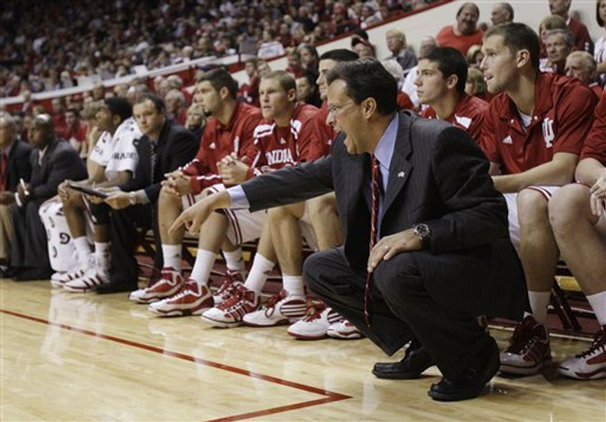 FILE - This Nov. 16, 2010, file photo shows Indiana coach Tom Crean shouting instructions to his team during the second half of an NCAA college basketball game against Mississippi Valley State in Bloomington, Ind.  Crean inherited a trainwreck at Indiana. Three years later, Crean has turned things around. (AP Photo/Darron Cummings, File)