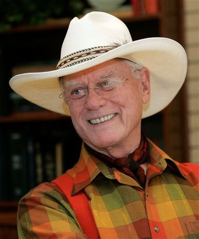 "FILE - In this Oct. 9, 2008 file photo, actor Larry Hagman responds to a question regarding his experience on the television show, ""Dallas"", at the Southfork Ranch in Parker, Texas. Hagman will be paying a visit to Wisteria Lane when the former ""Dallas"" star appears in a guest role on ""Desperate Housewives.""  (AP Photo/Tony Gutierrez, file)"