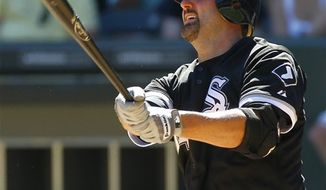FILE - This Aug. 27, 2010, file photo shows Chicago White Sox's Paul Konerko celebrating in the dugout after he and Carlos Quentin scored on a double by A.J. Pierzynski off New York Yankees starting pitcher A.J. Burnett, during the first inning of a baseball game, in Chicago. Konerko has decided to stay with the White Sox, agreeing to a $37.5 million, three-year contract.  The first baseman, a four-time All-Star, gets $12 million in each of the next two seasons and $13.5 million in 2013 under Wednesday's, Dec. 8, 2010,  agreement. (AP Photo/Charles Rex Arbogast, File)