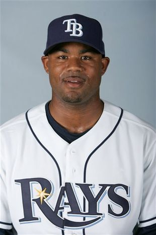 FILE - This is a 2008 file photo of Carl Crawford of the Tampa Bay Rays baseball team. A night after Carl Crawford enjoyed a steak dinner with the New York Yankees, he served up a meaty surprise: He's going to play for the rival Boston Red Sox. A person familiar with the talks told The Associated Press late Wednesday Dec. 8, 2010 the agreement was subject to Crawford passing a physical.   (AP Photo/Chris O'Meara, File)