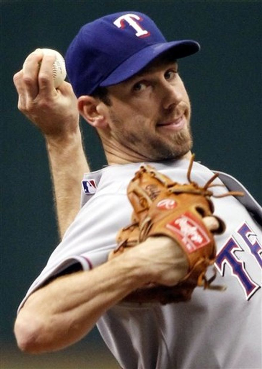 FILE - This Oct. 6, 2010, file photo shows Texas Rangers' Cliff Lee  pitching during the first inning against the Tampa Bay Rays during Game 1 of the American League Division baseball series, in St. Petersburg, Fla. On Wednesday, Dec. 8, 2010, the New York Yankees made an offer to Lee, a six-year proposal worth nearly $140 million.(AP Photo/J. Meric, Pool File)