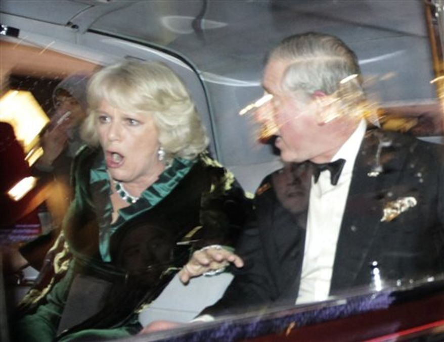 "Britain's Prince Charles and Camilla, Duchess of Cornwall, react as their car is attacked by angry protesters in London, Thursday, Dec. 9, 2010. An Associated Press photographer saw demonstrators kick the car in Regent Street, in the heart of London's shopping district. The car then sped off. Charles' office, Clarence House, confirmed that ""their royal highnesses' car was attacked by protesters on the way to their engagement at the London Palladium this evening, but their royal highnesses are unharmed."" (AP Photo/Matt Dunham)"