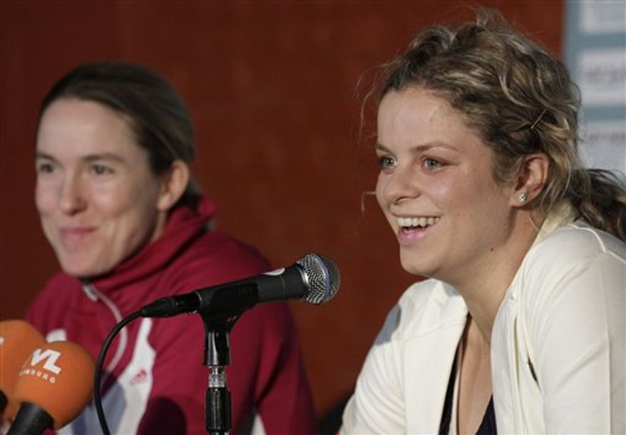 Belgium's Kim Clijsters, right, reacts with Belgium's Justine Henin  ahead of the Diamond Games exhibition match in Antwerp, Belgium, Thursday, Dec. 9, 2010. (AP Photo/Yves Logghe)