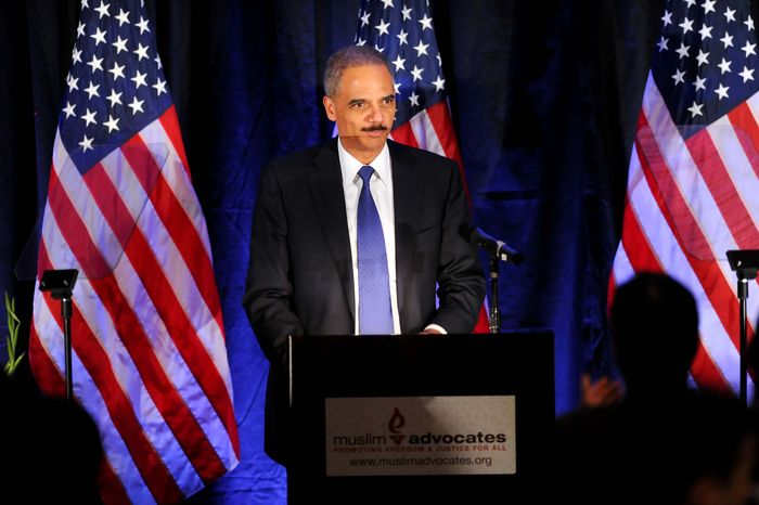 Attorney General Eric Holder speaks at the Muslim Advocates annual dinner on Friday, Dec. 10, 2010, in Millbrae, Calif. Holder used the speech before the Muslim advocacy group near San Francisco to reiterate his resolve to prosecute hate crimes. (AP Photo/Noah Berger)