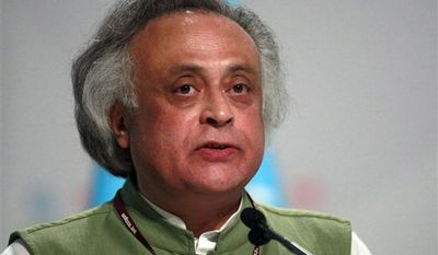Indian Environment Minister Jairam Ramesh delivers a speech during the United Nations Climate Change Conference in Cancun, Mexico, Wednesday  Dec. 8. (AP Photo/Israel Leal)