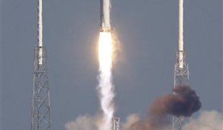 The SpaceX Falcon 9 rocket lifts off from pad 40 at the Cape Canaveral Air Force Station in Cape Canaveral, Fla., Wednesday, Dec. 8, 2010.(AP Photo/John Raoux)