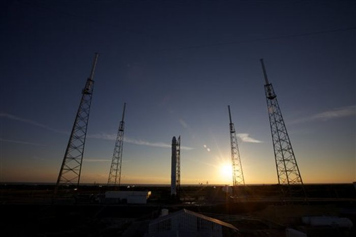 A Wednesday, Dec. 8, 2010 photo provided by SpaceX shows the SpaceX Falcon 9/Dragon rocket at Launch Complex 40 at Cape Canaveral Air Force Station in Cape Canaveral, Fla. SpaceX plans to make its first launch attempt in a demonstration test Wednesday for NASA's Commercial Orbital Transportation Services (COTS) program. (AP Photo/SpaceX, Chris Thompson)
