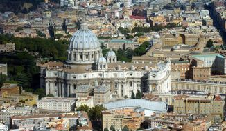 ** FILE ** The Vatican, with St. Peter's Basilica in the center, is seen in a 2003 aerial view. (AP Photo/Plinio Lepri, File)