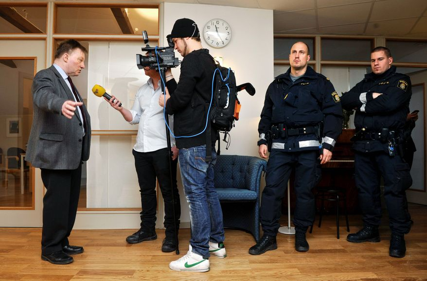 Claes Borgstrom (left), the lawyer for the two women who claim to have been sexually assaulted by WikiLeaks founder Julian Assange in Sweden in August, talks to the media at his office in Stockholm on Wednesday. Mr. Borgstrom, whose office is under police protection, denied that the case had anything to do with WikiLeaks or the current U.S. interest in Mr. Assange. (Associated Press)