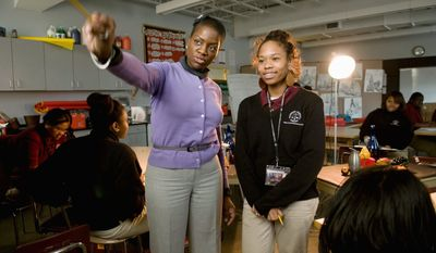 Art teacher Nafeesah Shabazz instructs drawing student Mignon Hemsley, a 17-year-old senior, at the Thurgood Marshall Academy in Anacostia on Wednesday. (J.M. Eddins/The Washington Times)