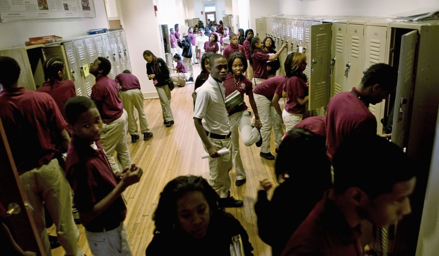 Students change classes at the Thurgood Marshall Academy Public Charter High School in the Anacostia neighborhood of Washington on Wednesday. (J.M. Eddins/The Washington Times)