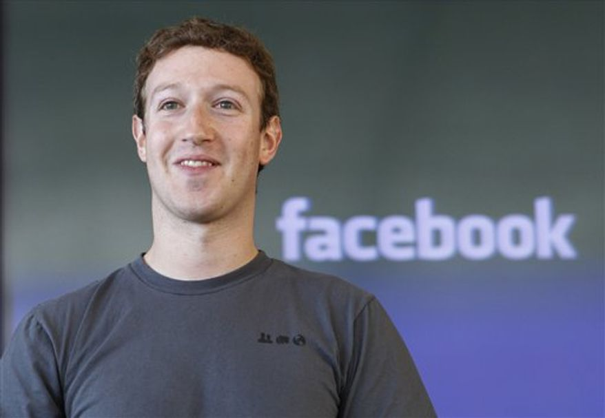 FILE - In this Nov. 15, 2010 file photo shows Facebook CEO Mark Zuckerberg smiling at an announcement in San Francisco. Another 17 of America's richest people, including Zuckerberg, junk bond pioneer Michael Milken and AOL co-founder Steve Case, have pledged to give away most of their wealth.  They are the latest to join the Giving Pledge, an effort led by Microsoft founder Bill Gates and investor Warren Buffett to commit the country's wealthiest people to step up their charitable donations. (AP Photo/Paul Sakuma, file)