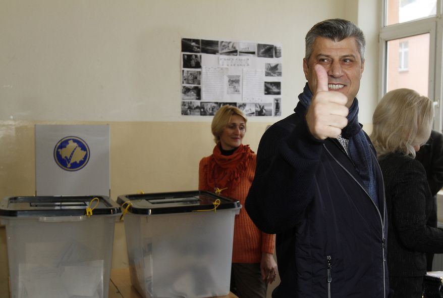 Hashim Thaci, leader of the Democratic Party of Kosovo, gives a thumbs up as he arrives to cast his ballot in general elections in Kosovo's capital, Pristina, on Sunday, Dec. 12, 2010. Kosovars were voting in the first general poll since the country's declaration of independence from Serbia in 2008, a critical election already marred by ethnic tension that many feared would split the world's newest country. (AP Photo/Visar Kryeziu)