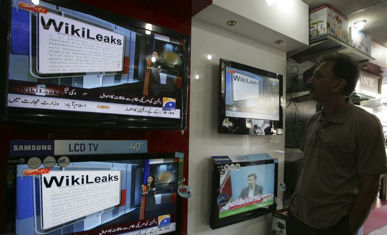 **FILE** A man watches Wikileaks memos at an electronic shop in Karachi, Pakistan on Dec. 2. (Associated Press)