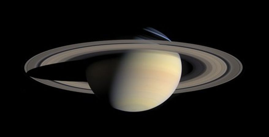 This image provided by NASA, taken Oct. 6, 2004, by the Cassini Saturn Probe, shows the planet Saturn and its rings. One of the most evocative mysteries of the solar system, where Saturn got its stunning rings, may actually be a case of cosmic murder with an unnamed moon of Saturn, that disappeared about 4.5 billion years ago, as the potential victim. Suspicion has fallen on a disk of hydrogen gas, that surrounded Saturn when its dozens of moons were forming, but has now fled the scene. And the cause of death? A possible forced plunge into Saturn. (AP Photo/NASA)