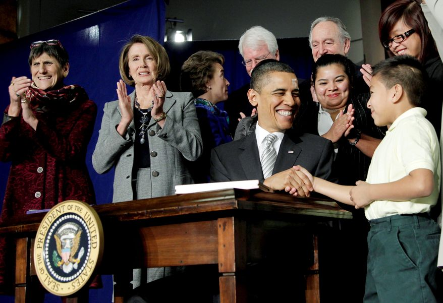 President Obama is congratulated by third-grader Luis Avilar-Turcios, 8, after signing the Healthy, Hunger-Free Kids Act of 2010 at Harriet Tubman Elementary School in the District. Rep. Rosa DeLauro, Connecticut Democrat (left), and House Speaker Nancy Pelosi, California Democrat (second from left), also attended. (Associated Press)