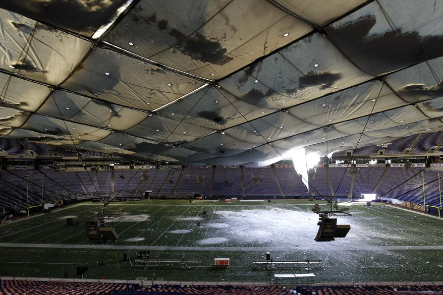 Snow falls into the field from a hole in the collapsed roof of the Metrodome in Minneapolis Sunday, Dec. 12, 2010. The inflatable roof of the Metrodome collapsed Sunday after a snowstorm that dumped 17 inches (43 cms) on Minneapolis. No one was hurt, but the roof failure sent the NFL scrambling to find a new venue for the Vikings' game against the New York Giants. (AP Photo/Ann Heisenfelt)