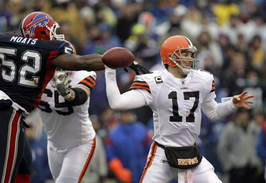 Buffalo Bills' Arthur Moats (52) forces a fumble on Cleveland Browns quarterback Jake Delhomme (17) during the second half of an NFL football game in Orchard Park, N.Y., Sunday, Dec. 12, 2010. The Bills won 13-6. (AP Photo/David Duprey)