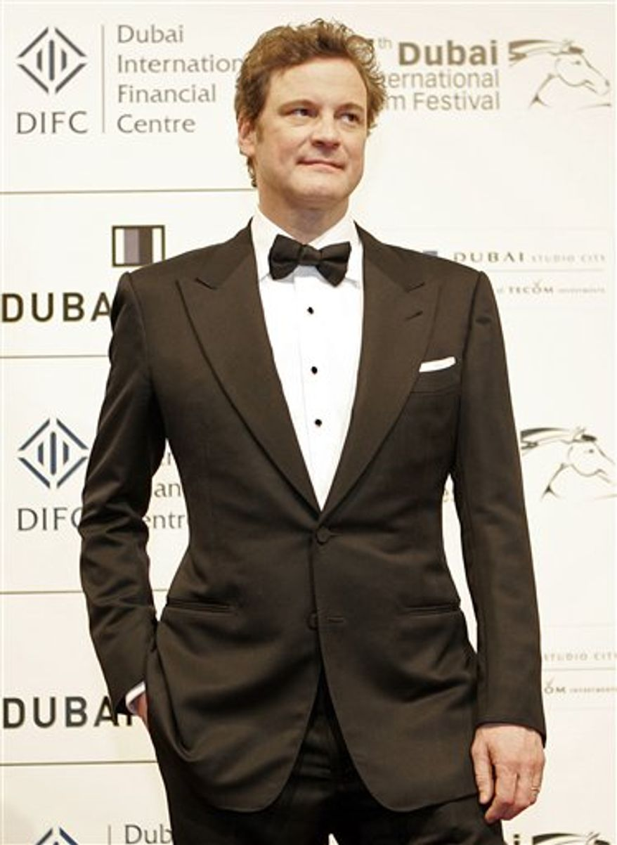 Colin Firth arrives at the red carpet during the first day of Dubai Film Festival in Dubai, Sunday, Dec. 12, 2010. (AP Photo/Farhad Berahman)