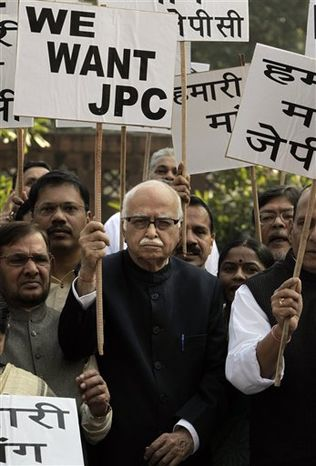 From right, Congress party president Sonia Gandhi, Indian Prime Minister Manmohan Singh, Vice President Hamid Ansari and opposition Bharatiya Janata Party leader Lal Krishna Advani, pay homage to the victims of the 2001 attack on the Indian parliament in New Delhi, India, Monday, Dec. 13, 2010. The four-week winter session of India's parliament ended Monday without conducting any legislative business, paralyzed throughout by an angry opposition demanding a probe into a telecommunications scandal that cost the country billions. (AP Photo/Manish Swarup)