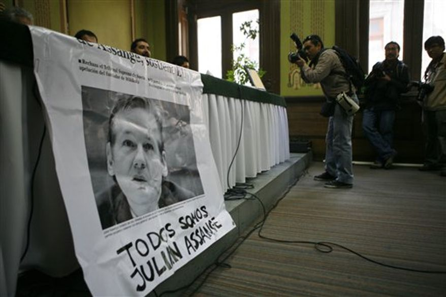 "A banner with an image of Wikileaks founder Julian Assange that reads in Spanish: ""We are all  Julian Assange,"" is seen during a press conference in Mexico City, Thursday, Dec. 9, 2010. Human rights activists, lawmakers and writers participated in a ceremony to unveil a plaque honoring Assange at the Club of Journalists. (AP Photo/Miguel Tovar)"
