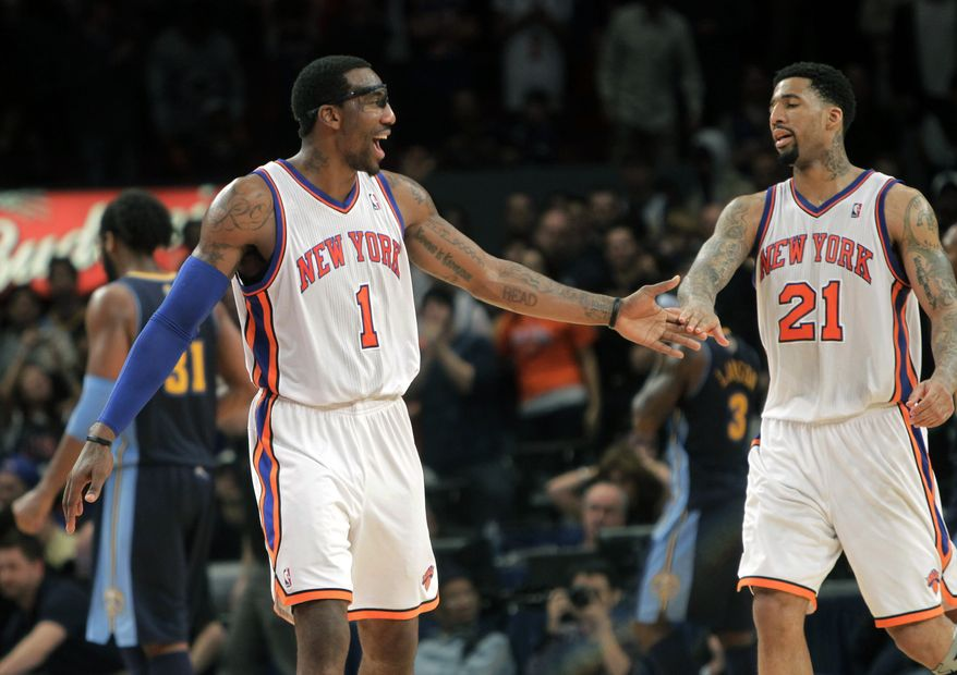 New York Knicks' Amare Stoudemire (1) celebrates with teammate Wilson Chandler (21) during the Knicks' 129-125 victory over the Denver Nuggets in New York on Sunday. (Associated Press)