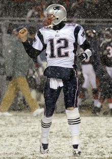 New England Patriots quarterback Tom Brady reacts after throwing a touchdown pass against the Chicago Bears in the first half of the Patriots' 36-7 victory in Chicago on Sunday. (Associated Press)