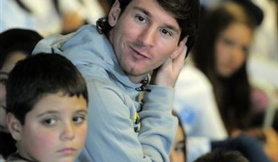 Barcelona's Argentinian forward and  Ambassador of Unicef Lionel Messi takes part in a children's session at the team's Camp Nou stadium in Barcelona, Spain, Thursday, Dec. 9, 2010. (AP Photo/Manu Fernandez)