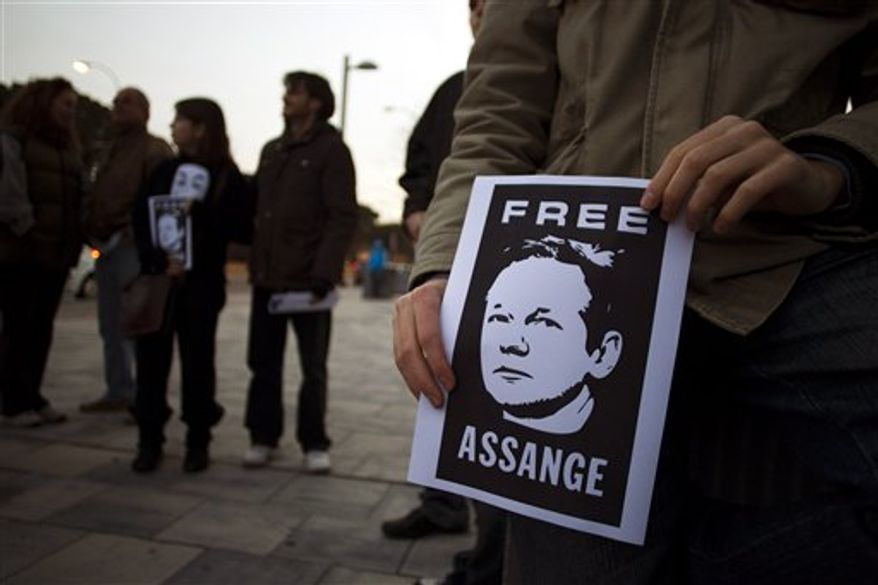 Supporters of WikiLeaks founder, Julian Assange, hold posters with his photo during a protest in front of the British Embassy in Madrid, Spain, Saturday, Dec. 11, 2010. WikiLeaks has been under intense pressure since it began publishing thousands of secret U.S. diplomatic cables, who is now in a British jail fighting extradition to Sweden on alleged sex crime charges.(AP Photo )