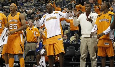 Tennessee's Steven Pearl (22) and Cameron Tatum (23) celebrates after a basket in the second half of the NCAA college basketball game against Pittsburgh in the SEC-Big East Invitational in Pittsburgh, Saturday, Dec. 11, 2010. Tennesee won 83-76. (AP Photo/Keith Srakocic)