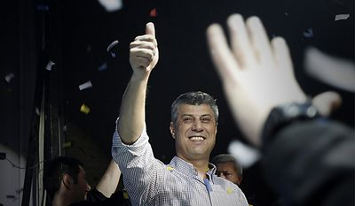 Kosovo's Prime Minister and leader of Democratic Party of Kosovo (PDK) Hashim Thaci gestures at his supporters celebrating victory in capital Pristina on Sunday, Dec. 12, 2010. Thaci has claimed victory in Kosovo's first general election since the province declared independence from Serbia, as an independent exit poll showed his Democratic Party of Kosovo 6 percentage points ahead of its rivals. (AP Photo/Visar Kryeziu)