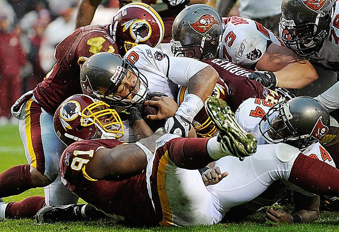 Tampa Bay Buccaneers quarterback Josh Freeman pushes across the goal line for a two-point conversion during the second half of an NFL football game against the Washington Redskins in Landover, Md., Sunday, Dec. 12, 2010. Tampa Bay won 17-16. (AP Photo/Nick Wass)