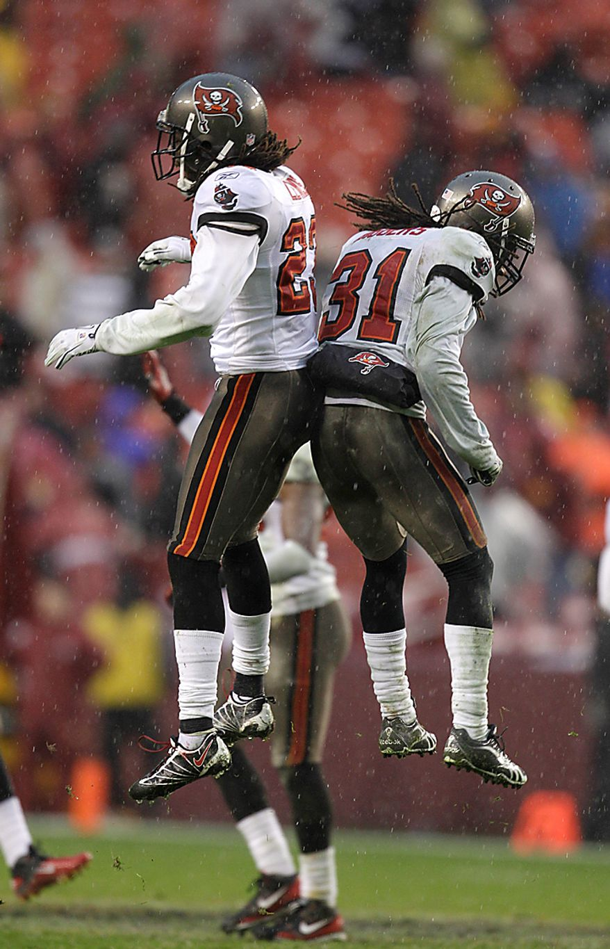Tampa Bay Buccaneers cornerback Myron Lewis, left, and E.J. Biggers (31) celebrate after the Washington Redskins' extra point kick was botched during the second half of an NFL football game in Landover, Md., Sunday, Dec. 12, 2010. Tampa Bay defeated the Redskins 17-16. (AP Photo/Rob Carr)
