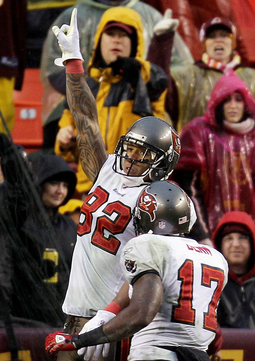 Tampa Bay Buccaneers tight end Kellen Winslow (82) celebrates a touchdown with teammate wide receiver Arrelious Benn (17) during the second half of an NFL football game against the Washington Redskins in Landover, Md., Sunday, Dec. 12, 2010. Tampa Bay defeated the Redskins 17-16. (AP Photo/Rob Carr)
