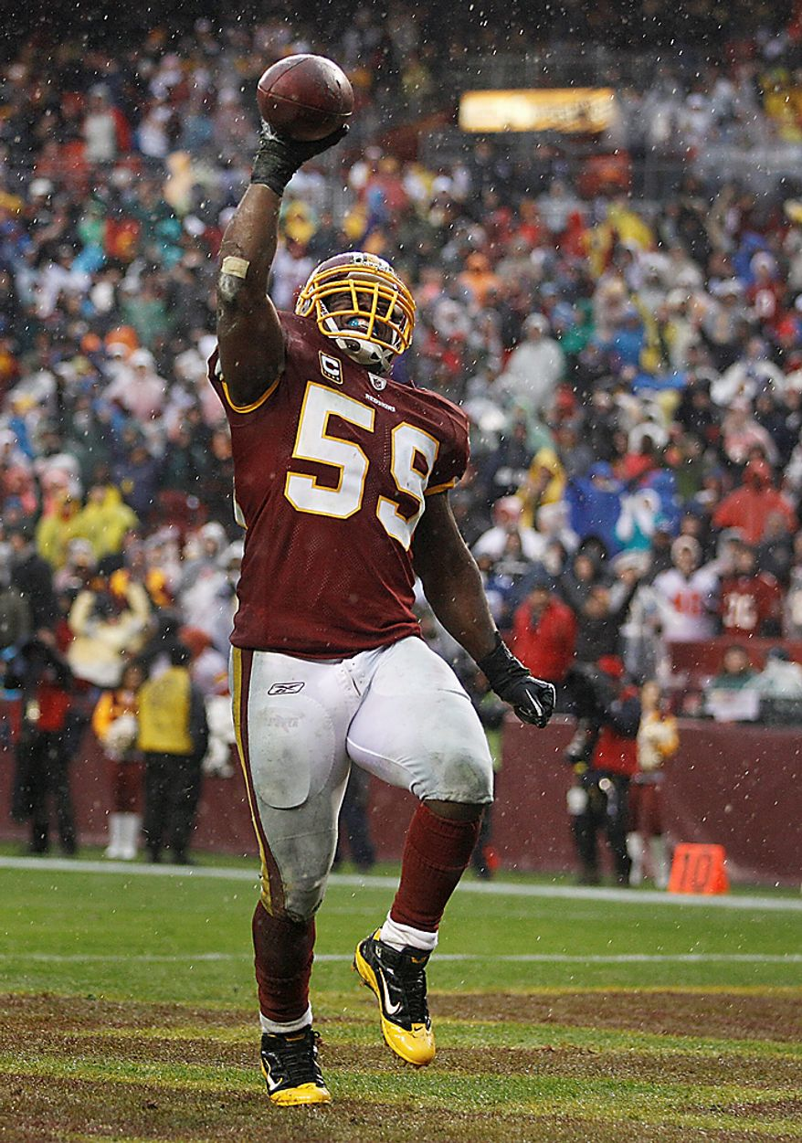 Washington Redskins linebacker London Fletcher celebrates his fumble recovery during the second half of an NFL football game against the Tampa Bay Buccaneers in Landover, Md., Sunday, Dec. 12, 2010. (AP Photo/Evan Vucci)
