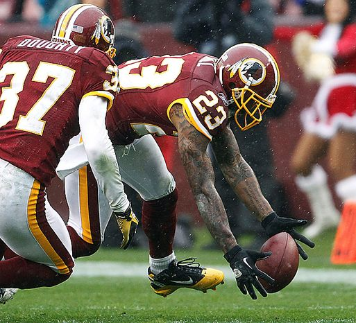Washington Redskins cornerback DeAngelo Hall (23) recovers a fumble from Tampa Bay Buccaneers running back LeGarrette Blount, not pictured, during the first half of an NFL football game in Landover, Md., Sunday, Dec. 12, 2010. (AP Photo/Evan Vucci)