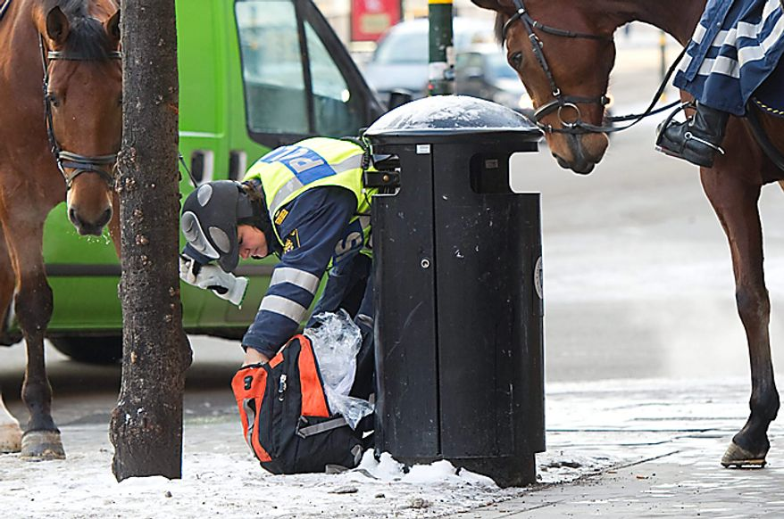 Mounted police officers check a  bag in Stockholm Monday Dec. 13, 2010  security has been stepped up in  the Swedish capital after Saturdays suicide bomb attack.(AP Photo/ Fredrik Sandberg)