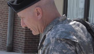 ** FILE ** Army Lt. Col. Terrence Lakin leaves the military courthouse at Fort Meade, Md., on Sept. 2, 2010. (AP Photo/David Dishneau, File)
