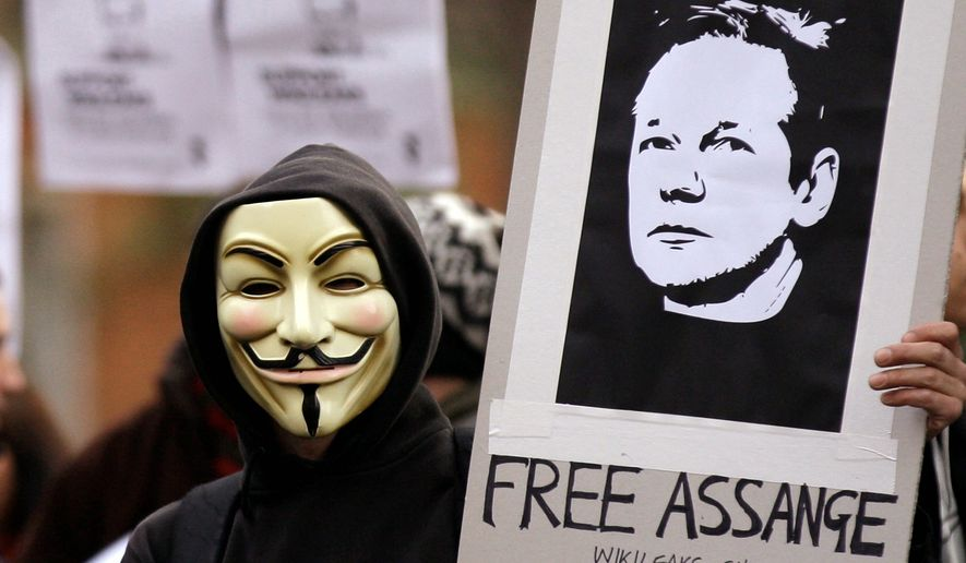 A supporter of Julian P. Assange demonstrates outside the courthouse in London where the WikiLeaks founder appeared for a bail hearing Tuesday. (Associated Press)
