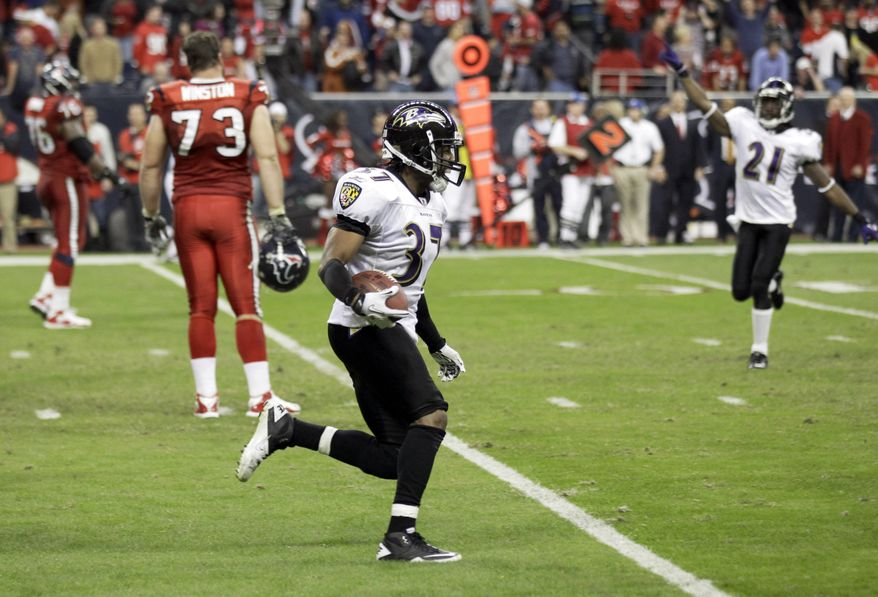 Baltimore Ravens defensive back Josh Wilson runs to the sideline after scoring a game-winning touchdown off an interception during overtime of an NFL football game against the Houston Texans Monday, Dec. 13, 2010, in Houston. The Ravens beat the Texans 34-28. (AP Photo/David J. Phillip)