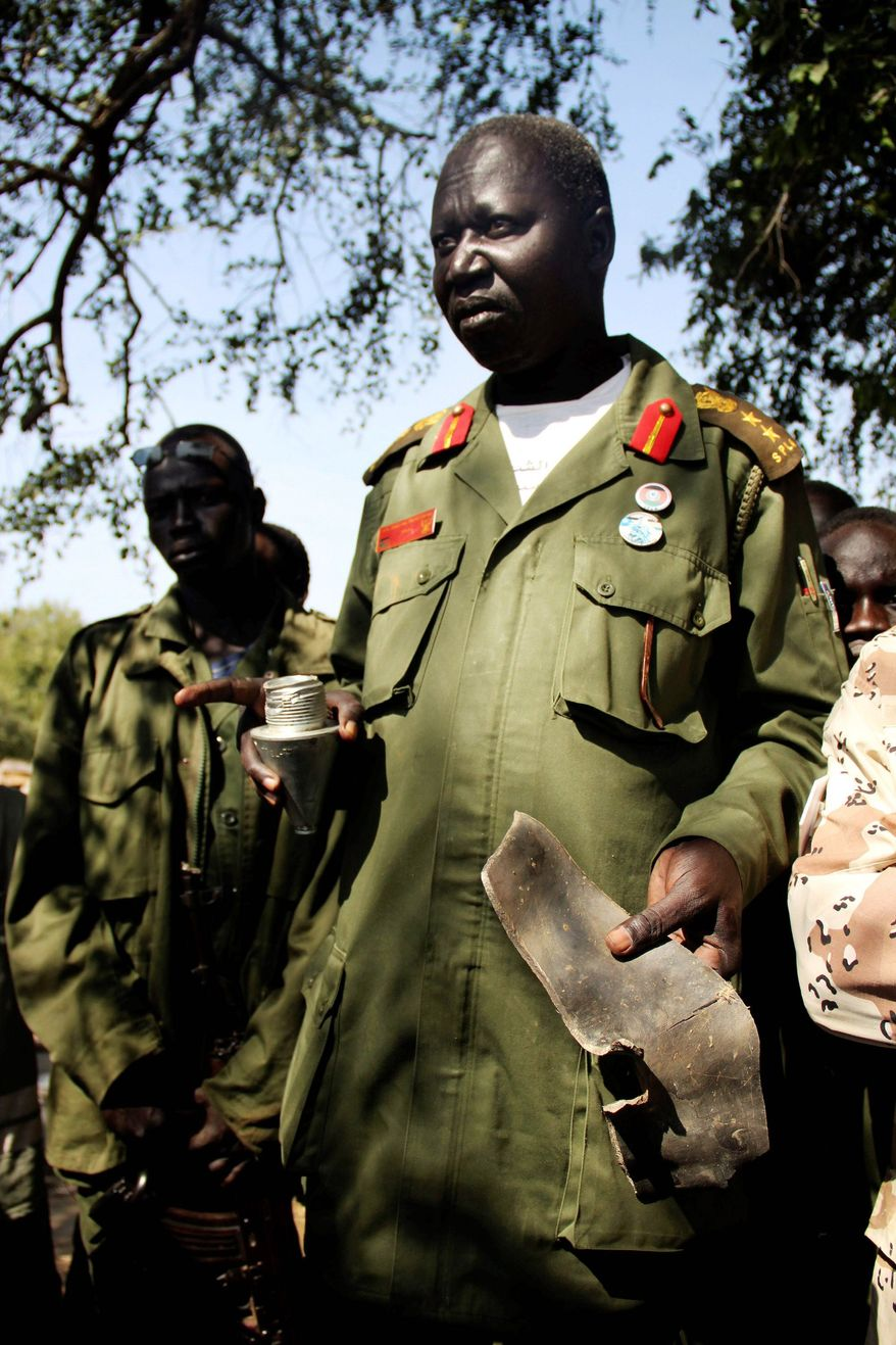 Sudan People's Liberation Army Col. Wieu Pal Padiet Deng, one of the top southern army officers in Northern Bahr el Ghazal state, holds remnants of munitions dropped by the northern Sudanese army on Kiir Adem on Saturday. Officials in the Khartoum-based north deny bombing areas under southern control and instead say southern officials are hosting Darfur rebels.
