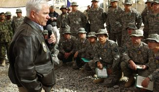 Associated Press Defense Secretary Robert M. Gates addresses U.S. troops while visiting Forward Operating Base Howz-E-Madad in Afghanistan's Kandahar province on Dec. 8.