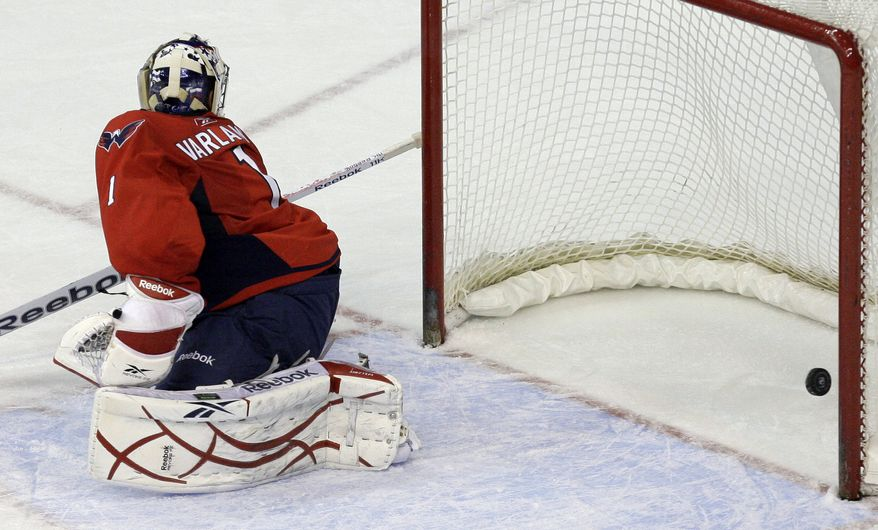 Washington Capitals goalie Semyon Varlamov (1), of Russia, looks back at the puck as the final goal is scored in overtime by the Anaheim Ducks at their NHL hockey game at the Verizon Center in Washington, on Wednesday, Dec. 15, 2010. The Ducks won 2-1. (AP Photo)
