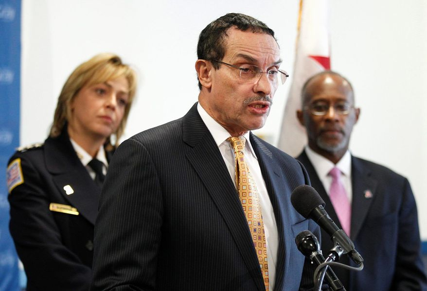 D.C. Mayor-elect Vincent C. Gray introduces his public-safety team, flanked by Police Chief Cathy L. Lanier, whom he renamed, and Paul. A. Quander Jr., his pick as deputy mayor for public safety. (Associated Press)