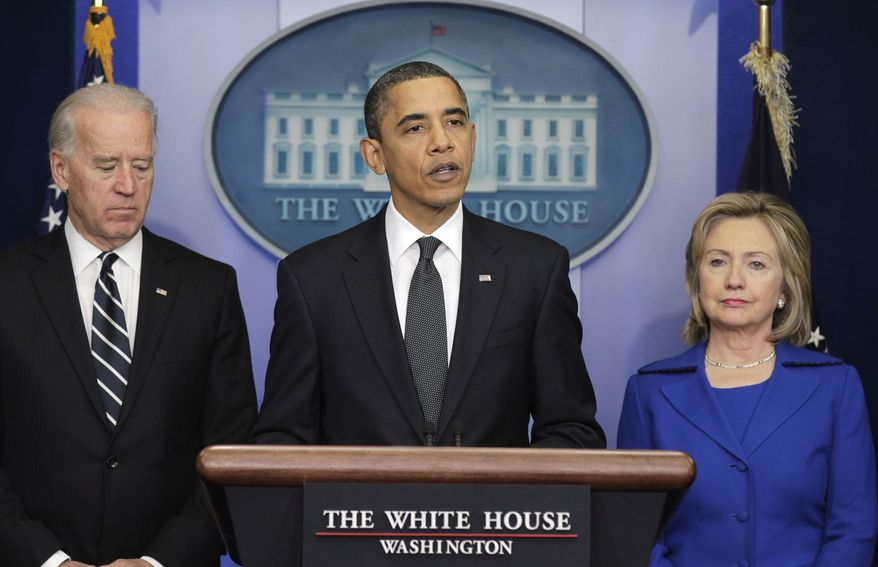 President Obama, accompanied by Vice President Joseph R. Biden (left) and Secretary of State Hillary Rodham Clinton, delivers a statement on Dec. 16, 2010, at the White House. (Associated Press) **FILE**