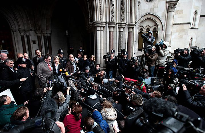 Mark Stephens, lawyer for WikiLeaks founder Julian Assange, back left, delivers a statement to the media outside the High Court in London, Thursday, Dec. 16, 2010. Mr. Assange will be freed on bail and sent to stay at a British country mansion, a judge ruled Thursday, rejecting prosecutors' attempts to keep Mr. Assange in prison as he fights extradition to Sweden. (AP Photo/Lefteris Pitarakis)
